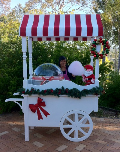 Our vintage cart with fairyfloss machine. Themed for Christmas.