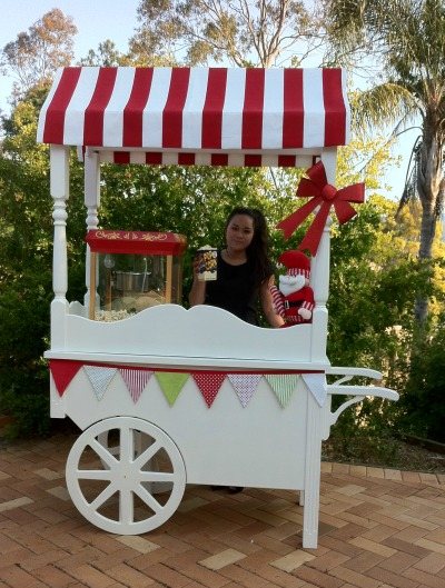Our vintage cart with popcorn machine. Themed for Christmas.