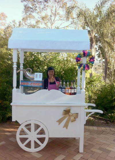Our vintage cart with snow cone machine. Themed for Christmas